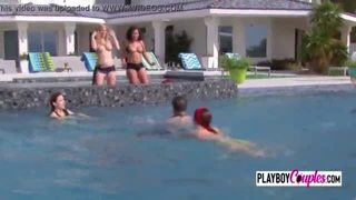 Couples steam things up as they get together in the pool for steamy foreplay
